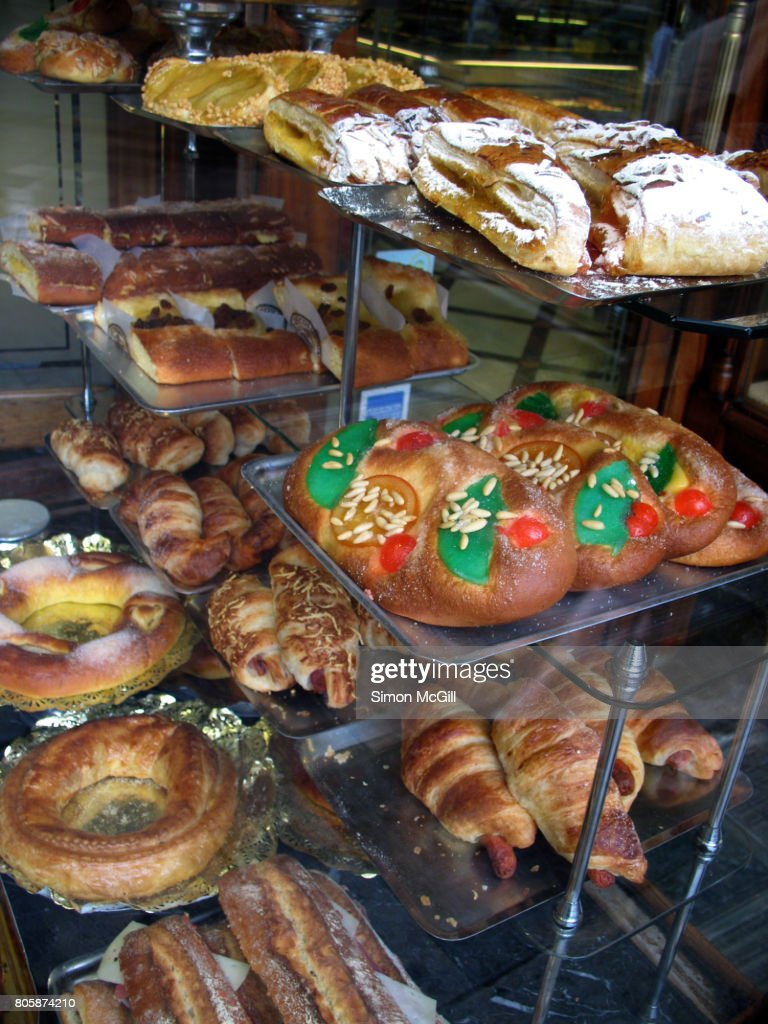 Savory And Sweet Baked Items For Sale In The Window Of A