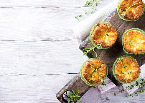 Savory cheddar cheese and leek mini quiches 579135746