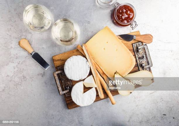 Savory dessert. Cheese platter served with dessert wine, jam and pear