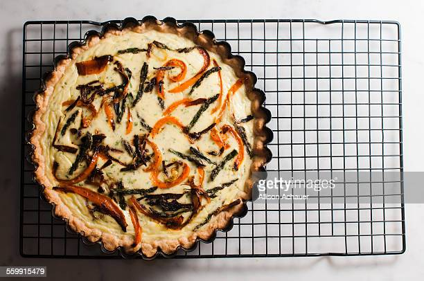 savory goat cheese tart with vegetables - cooling rack stock photos and pictures