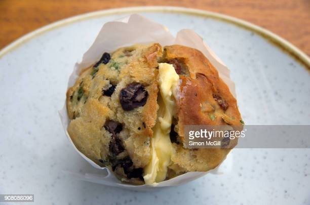 savoury muffin with kalamata olives, chorizo, and baby spinach served warm with butter - kalamata olive stock pictures, royalty-free photos & images