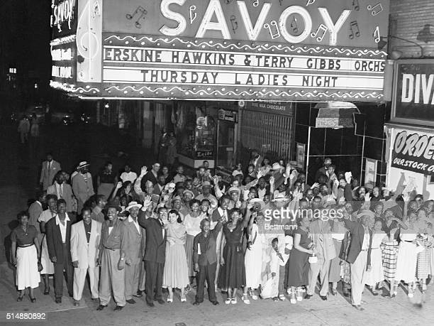 1952 Savoy Ballroom Harlem LandmarkA group of AfroAmerican people at the Savoy Ballroom excited after night of dancing