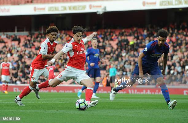 Savvas Mourgos of Arsenal shoots under pressue from Cameron BorthwickJackson of Man Utd during the Premier League 2 match between Arsenal U23 and...