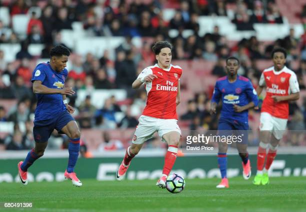 Savvas Mourgos of Arsenal takes on Demetri Mitchell of Man Utd during the Premier League 2 match between Arsenal U23 and Manchester United U23 at...