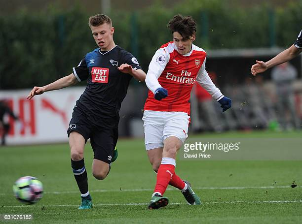 Savvas Mourgoue scores a goal for Arsenal under pressure from Calum MacDonald of Derby during the match between Arsenal U23 and Derby County U23 at...