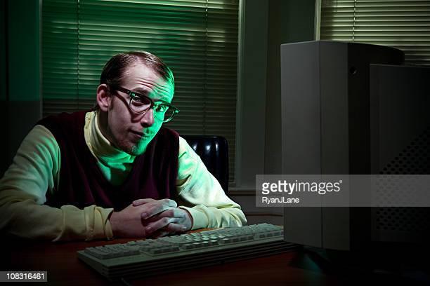 Savvy Tech Man In Dark Office