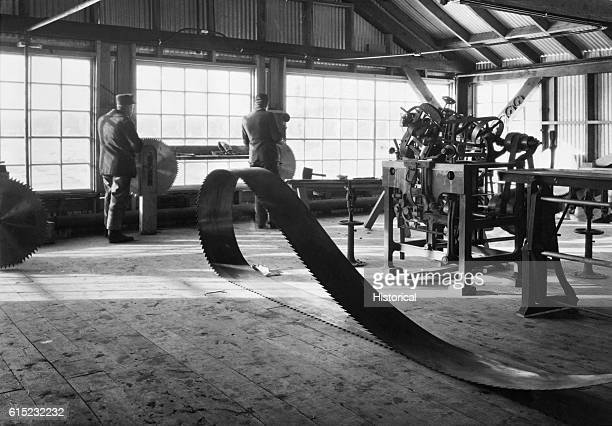 Saw blades are sharpened and stored in the filing room at the Government Sawmill on the Menominee Indian Reservation Wisconsin 1909 | Location...