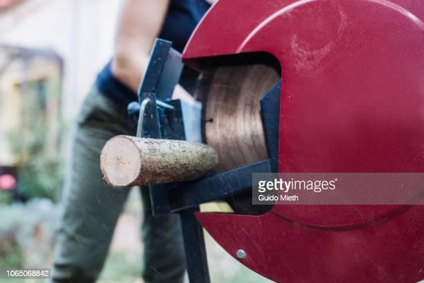 Saw cutting wood.