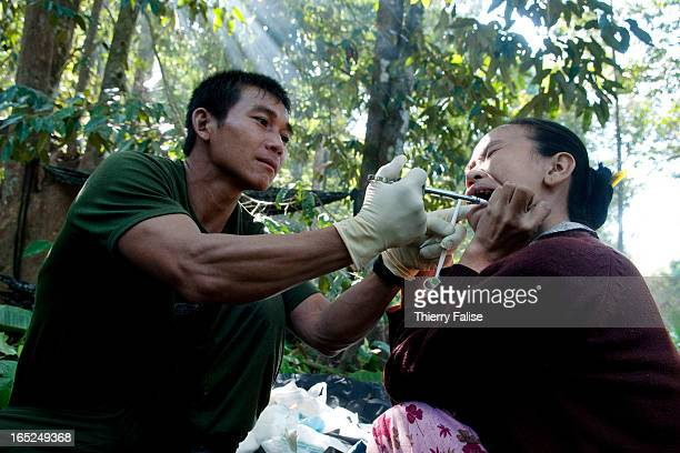 Saw Maw Naw a member of a Free Burma Rangers team provides dental treatment to a villager
