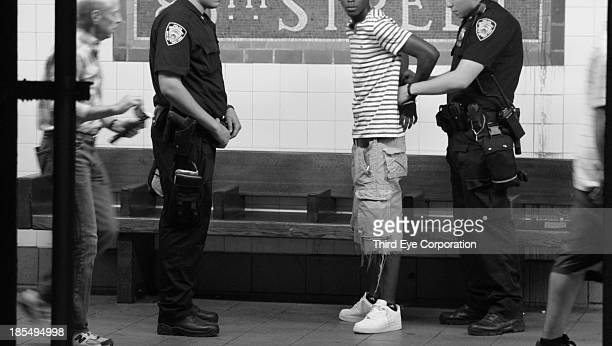 Saw this young man being stopped in NYC subway by two policemen.