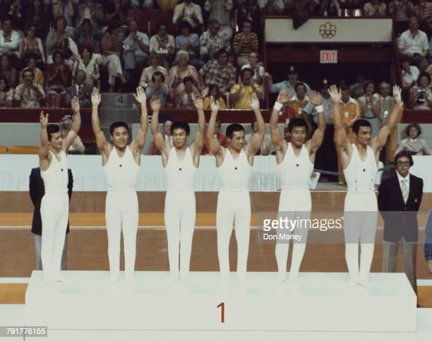 Sawao Kato Mitsuo Tsukahara Hiroshi Kajiyama Eizo Kenmotsu Hisato Igarashi and Shun Fujimoto of Japan stand on the podium after winning the Men's...