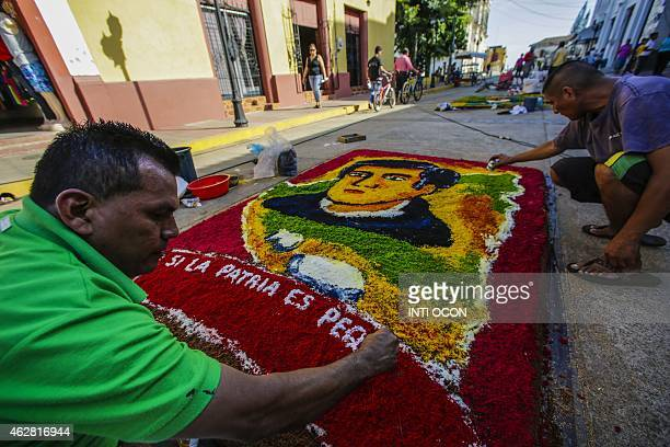 Sawdust carpets illustrating the different stages of life of Ruben Dario are created marking the centenary of his death in 'La Canzada Street' at...