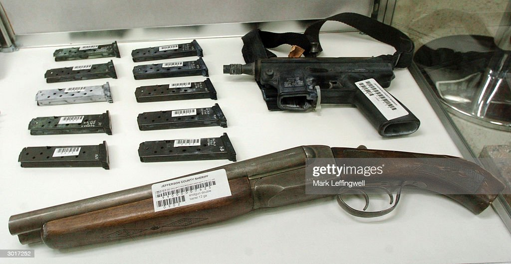 A sawed off double barrel shotgun, ammuntion clips and an automatic pistol used in the 1999 Columbine High School shooting are displayed in a glass case at the Jefferson County Fairgrounds February 26, 2004 in Golden, Colorado. Columbine students Eric Harris and Dylan Klebold killed 13 people at Columbine High School April 20, 1999 in Littleton, Colorado in the worst school shooting in U.S. history.