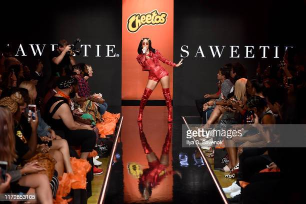 Saweetie performs onstage as Cheetos unveiled faninspired versions of the #CheetosFlaminHaute look at The House Of Flamin' Haute Runway Show Style...