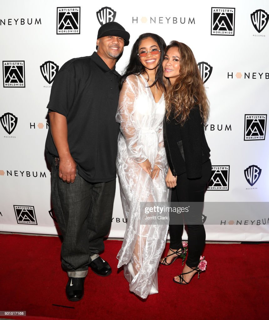 Saweetie poses with her parents Jonathan and Trinidad at her 'High Maintenance' Listening Event on March 12, 2018 in Hollywood, California.