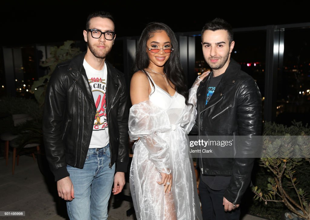 Saweetie (C) poses with Rap-Up Founders Devin Lazerine and Cameron Lazerine attend Saweetie's 'High Maintenance' Listening Event on March 12, 2018 in Hollywood, California.