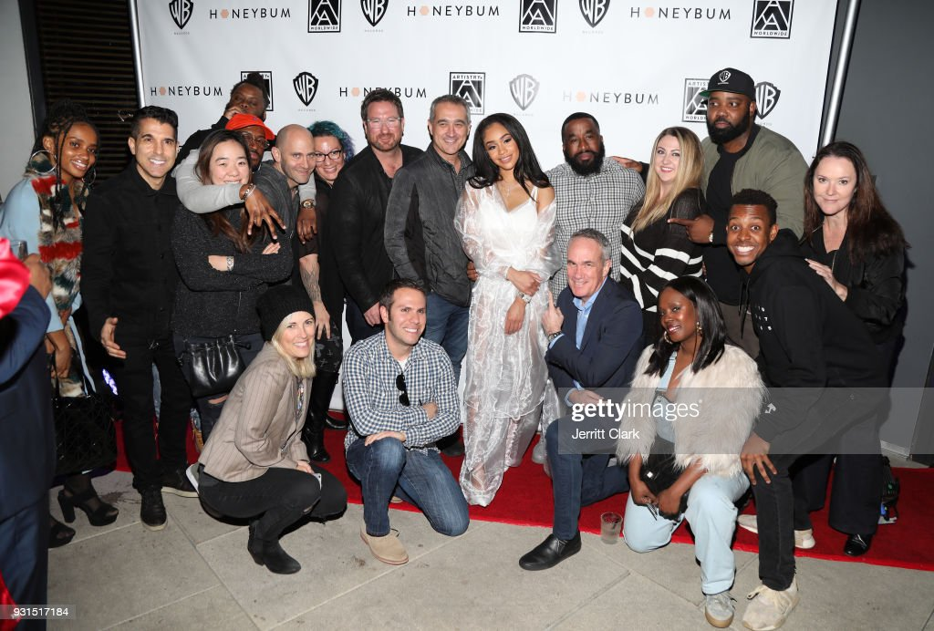 Saweetie poses with Warner Music executives and staff at her 'High Maintenance' Listening Event on March 12, 2018 in Hollywood, California.