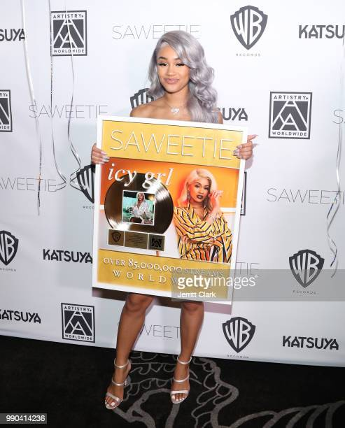 Saweetie receives a plaque for 85 Million streams during her Birthday Dinner at Katsuya on July 2 2018 in Los Angeles California