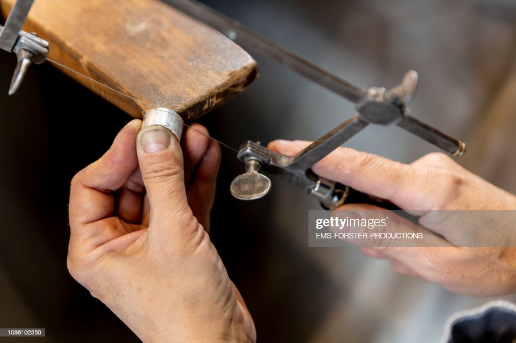 sawing  Goldsmith on workbench : Stock Photo