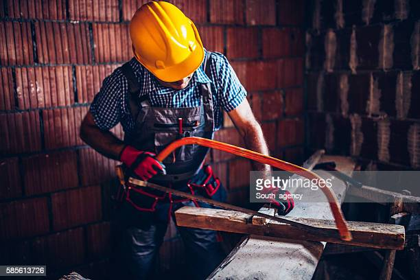 Sawing wooden batten with the hand saw
