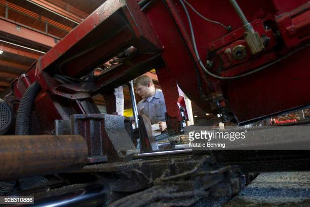 A sawyer cuts machine grade steel to be shipped throughout the Pacific Northwest at the Pacific Machinery Tool Steel Company on March 6 2018 in...
