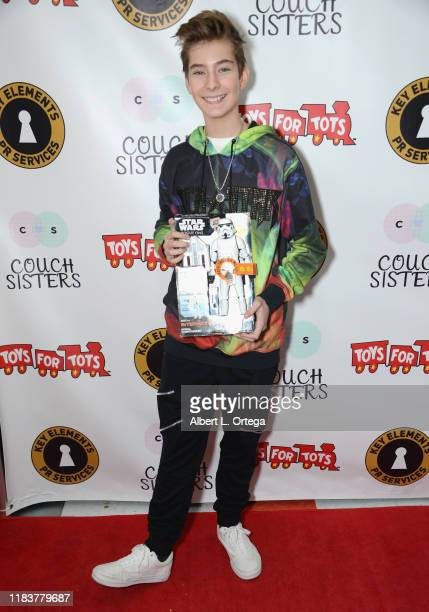 Sawyer Sharbino attends The Couch Sisters 1st Annual Toys For Tots Toy Drive held onNovember 20 2019 in Glendale California