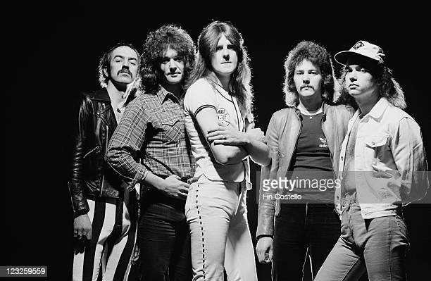 Saxon British heavy metal band pose for a group studio portait against a black background United Kingdom in May 1979