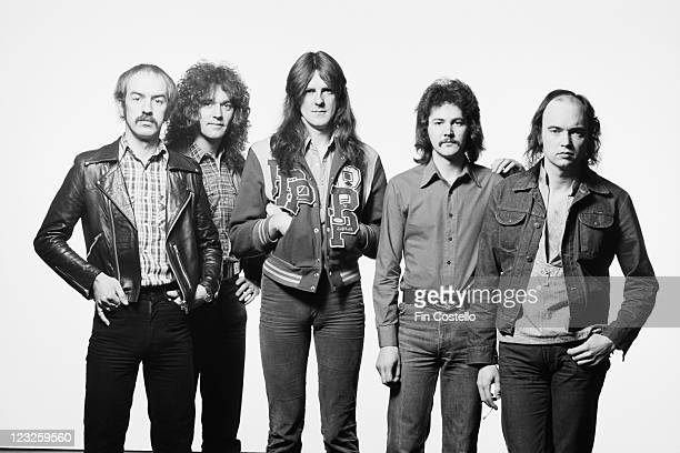 Saxon British heavy metal band pose for a group studio portait against a white background United Kingdom in May 1979
