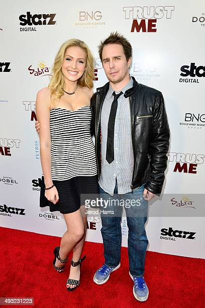 Saxon Sharbino and Sam Rockwell arrive at the Los Angeles Premiere of 'Trust Me' at the Egyptian Theatre on May 22 2014 in Hollywood California
