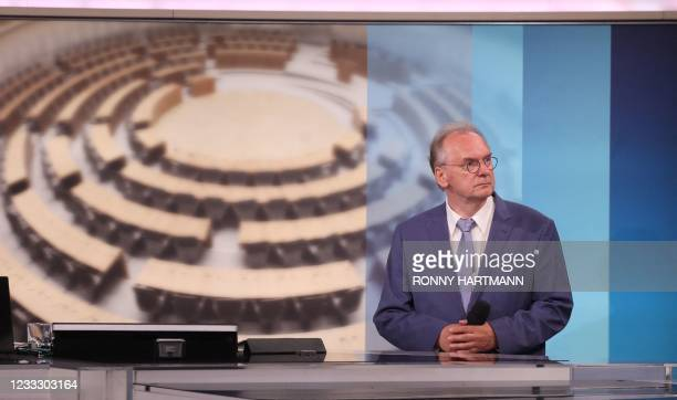 Saxony Anhalt's State Premier Reiner Haseloff, top candidate of his conservative Christian Democratic Union's party, attends a televised meeting...