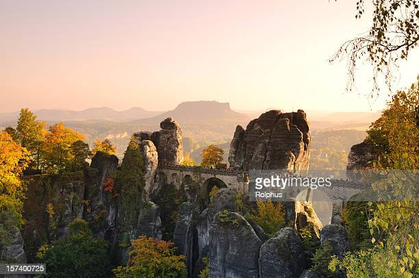 saxony bastei rocks bridge before sunset fall - sonnig stock pictures, royalty-free photos & images