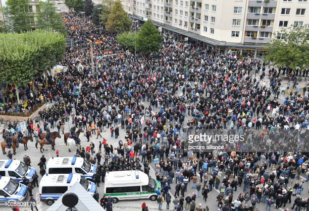 Participants of the rally of the rightwing populist civil movement Pro Chemnitz march through the city together with the participants of the...
