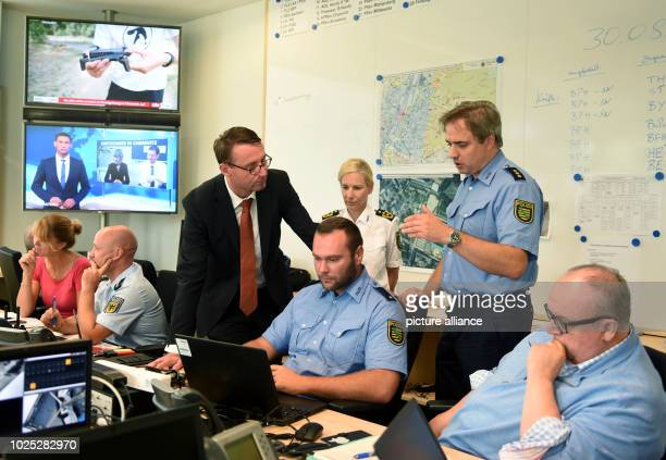 Saxony's Minister of the Interior Roland Wöller visits the situation centre of the Chemnitz police headquarters Sonja Penzel M r Dirk Heide On Sunday...