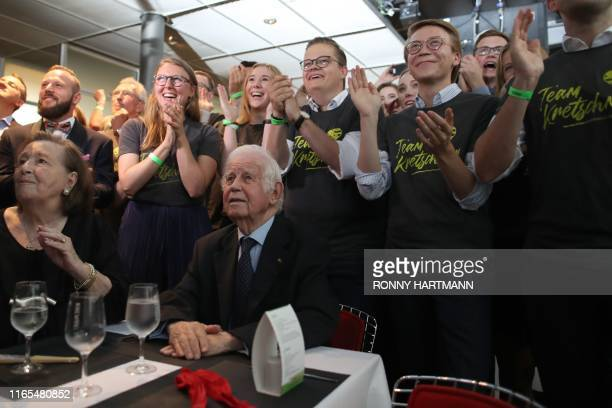 Saxony's former State Premier Kurt Biedenkopf looks on as supporters of the conservative Christian Democratic Union party react after the first...