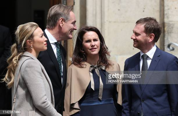 Saxonys Prime Minister Michael Kretschmer and his partner Annett Hofmann the Mayor of Leipzig Burkhard Jung and his wife Ayleena Jung stay in front...