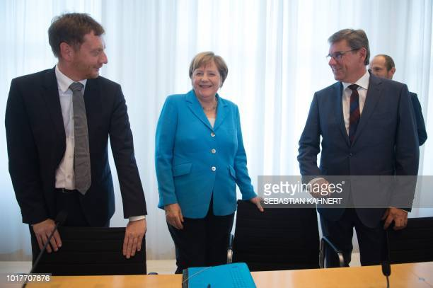 Saxony's Prime Minister Michael Kretschmer German Chancellor Angela Merkel and parliamentary party leader of the CDU in Saxony Frank Kupfer arrive...