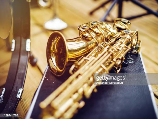 saxophone and clarinet waiting for the concert - wind instrument stock pictures, royalty-free photos & images