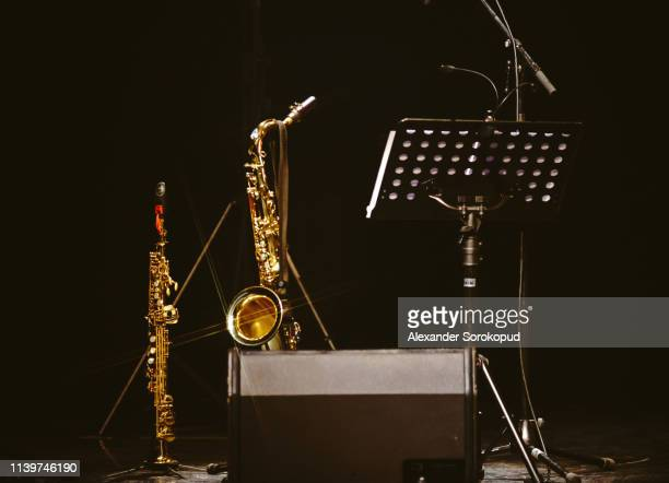 saxophone and clarinet waiting for the concert - classical concert stock pictures, royalty-free photos & images