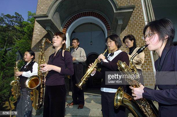LIVES AFPLIFESTYLETAIWANINDUSTRYMANUFACTURINGMUSICSAXOPHONE Saxophone maker Chang Tsongyao his wife Wang Tsaijui and their four daughters play their...