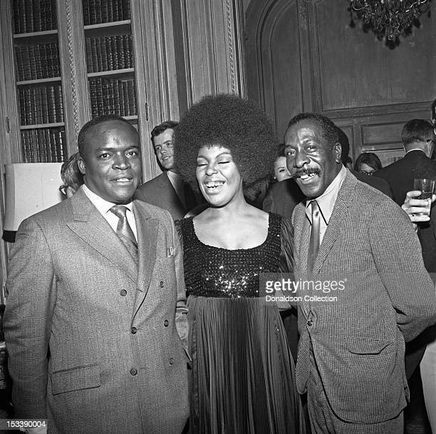 Saxophone player and record producer King Curtis , singer Roberta Flack and party guests at an Atlantic Records party in her honor at the St. Regis...