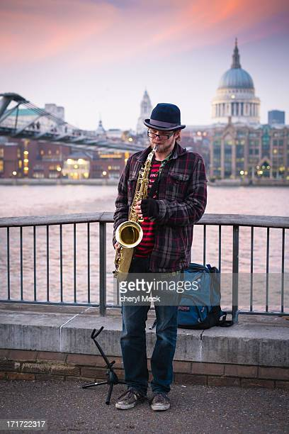 CONTENT] Saxophone player busking on the South Bank opposite St Pauls and during Sunset