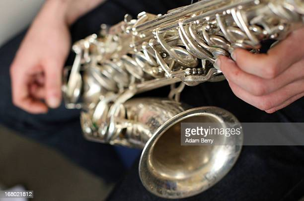 A saxophone player in the ORSO Rock Symphony Orchestra rehearses for the ORSO RockSymphonyNight in the Evangelische PhilippusNathanael...