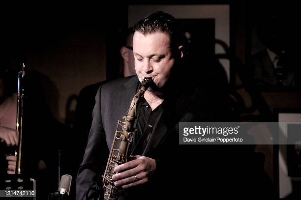 Saxophone player Nicholas Blake performs live on stage at Ronnie Scott's Jazz Club in Soho London on 5th August 2009