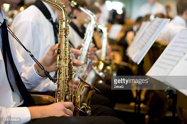 Saxophone player performing on orchestra