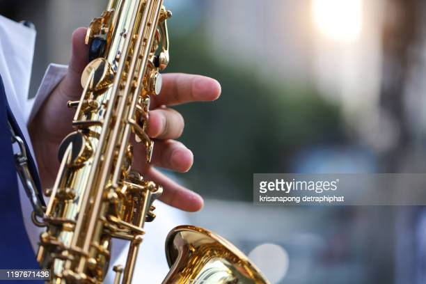 saxophone,international jazz day and world jazz festival. saxophone, music instrument played by saxophonist player musician in fest. - saxophone stock pictures, royalty-free photos & images