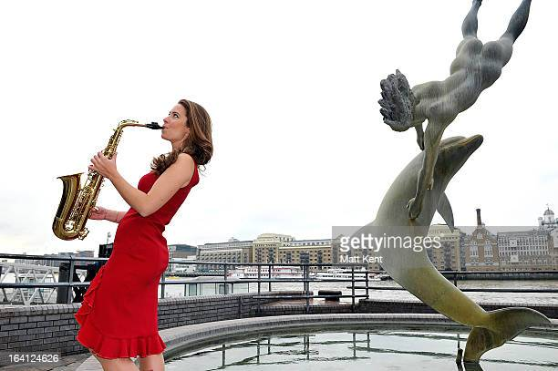 Saxophonist Amy Dickson performs to welcome the first day of Spring on March 20 2013 in London England