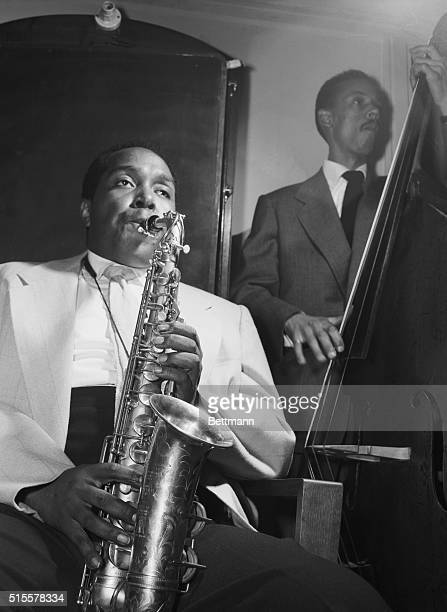 Saxophonist Charlie Parker practices in his dressing room before performing at the International Jazz Festival of 1949 in Paris.