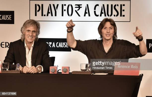 Saxophonist Chris White and guitarist Terence Reis members of British rock band Dire Straits during the press conference on March 16 2017 in Gurgaon...