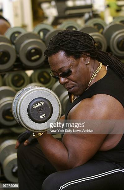 Saxophonist Clarence Clemons also known as 'the Big Man' in Bruce Springsteen's E Street Band does barbell curls at a gym in the Trump International...