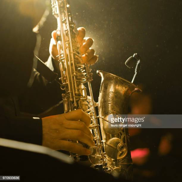 saxophonist detail - saxophone stock pictures, royalty-free photos & images